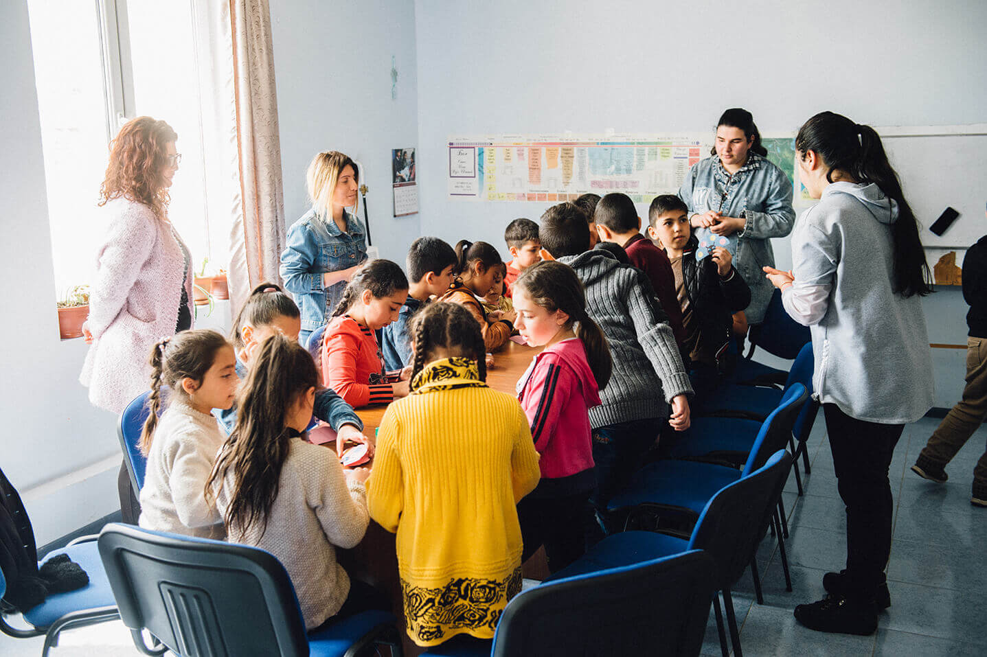 Lilit, standing second from left, leads children's ministry.