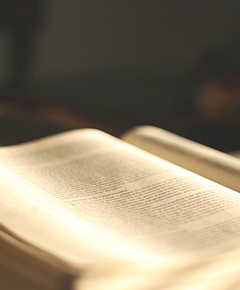 A Bible opened with a dark background